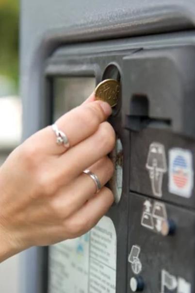 Kleingeld in parkeerautomaat